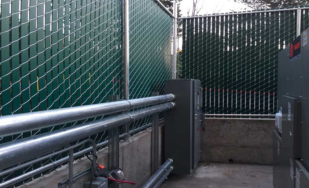 Chain link fence with green privacy slats