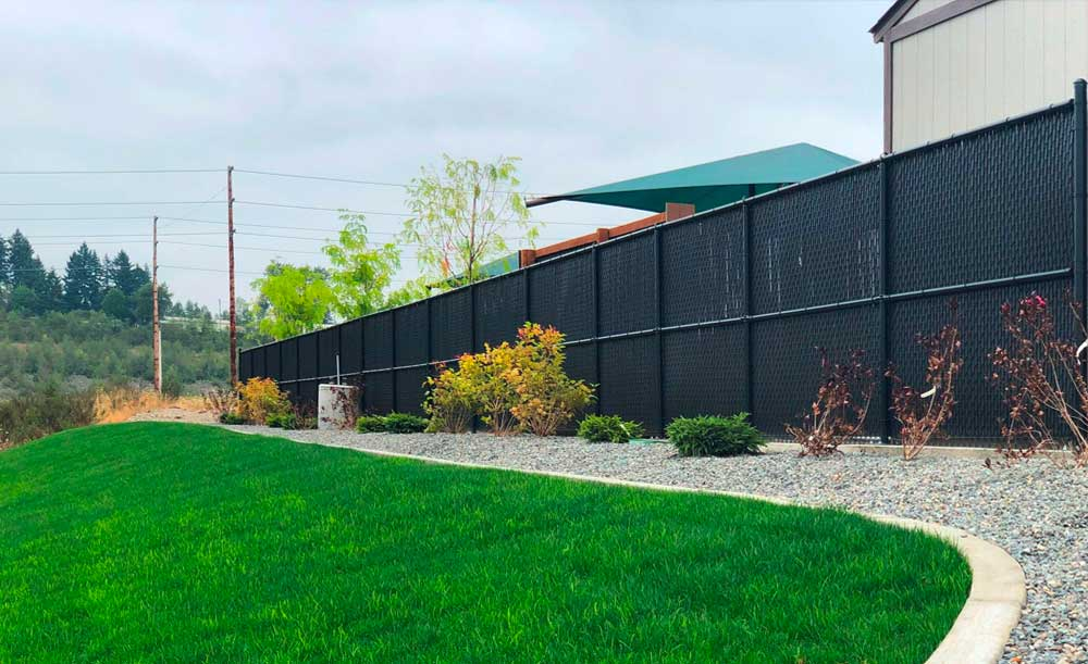 Black chain link with black privacy slats and mid rail