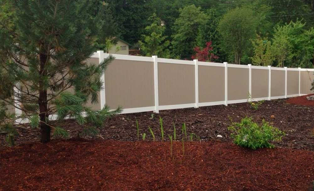 White and Tan privacy vinyl fence