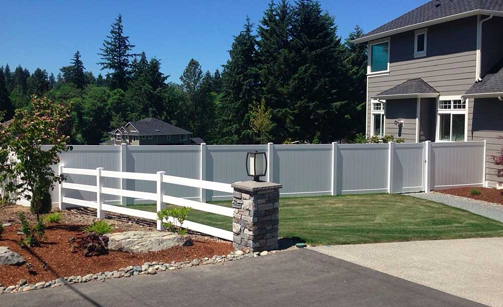 3-Rail and white privacy vinyl fence