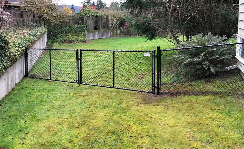 Black chain link fence with double gate