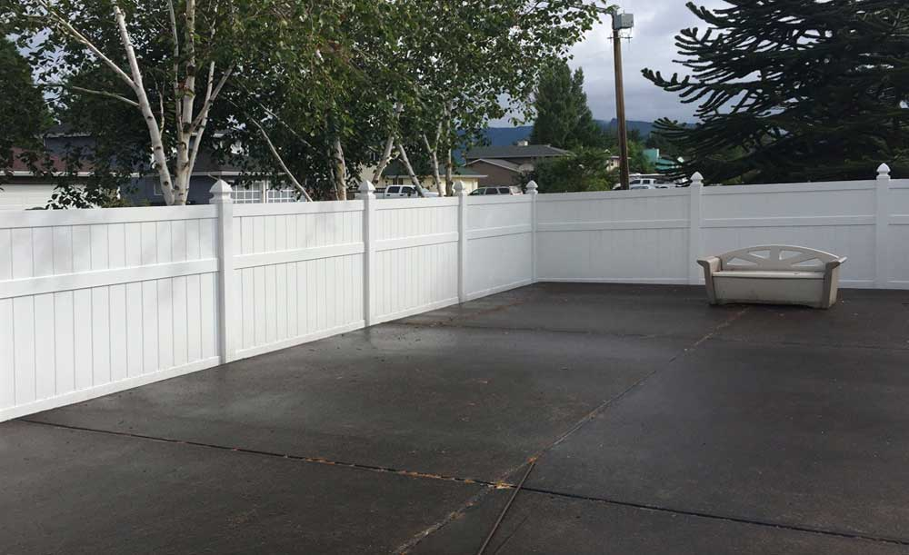 White Privacy with mid-rail vinyl fence