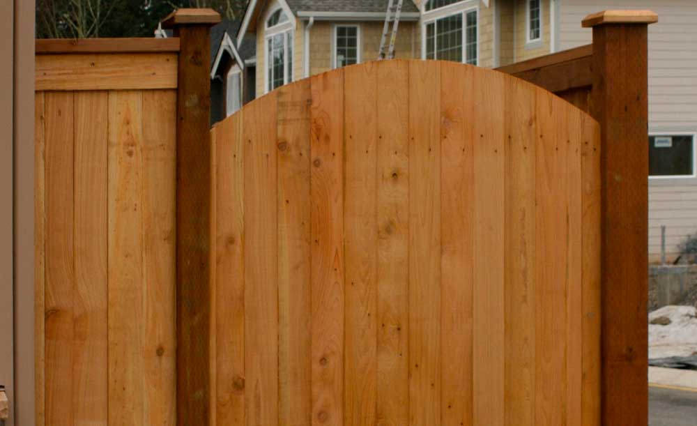 Full Panel style cedar fence with crown top gate