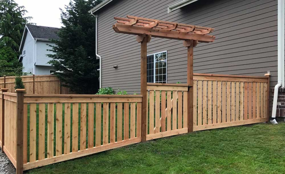 Full Panel style cedar fence with space, gate and trellis