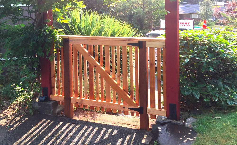 Full Panel style cedar fence with spaced alternating boards and gate