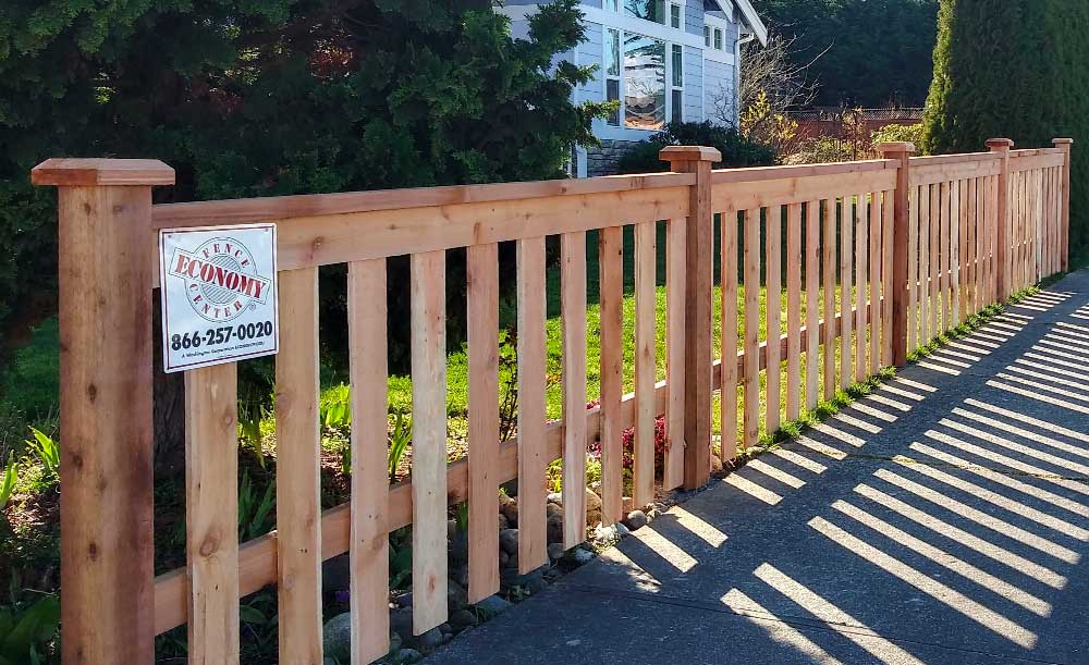 Modified Panel style cedar fence with space and cedar pipe-base posts