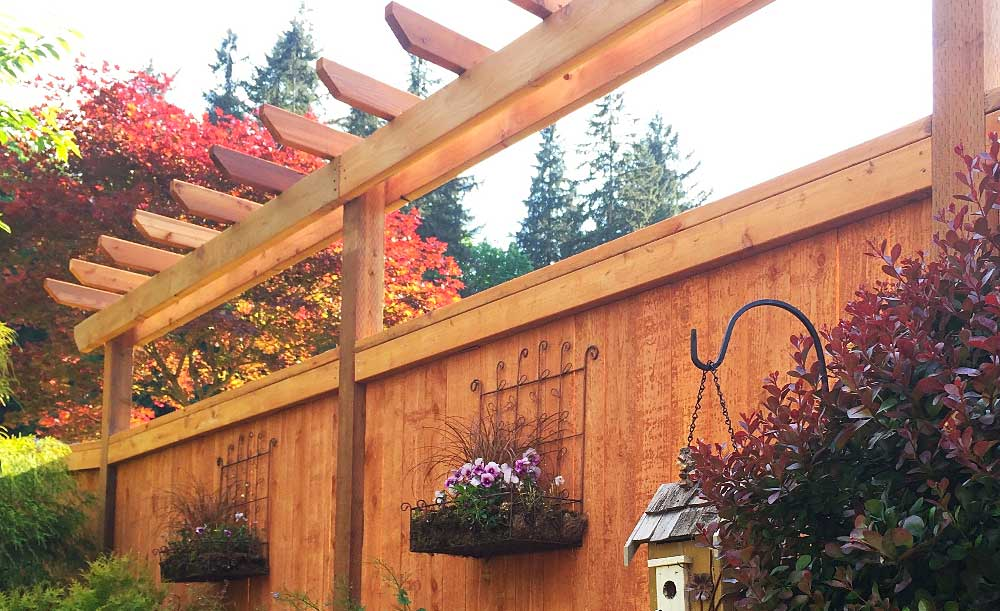 Modified Panel style pre-stained cedar fence with trellis