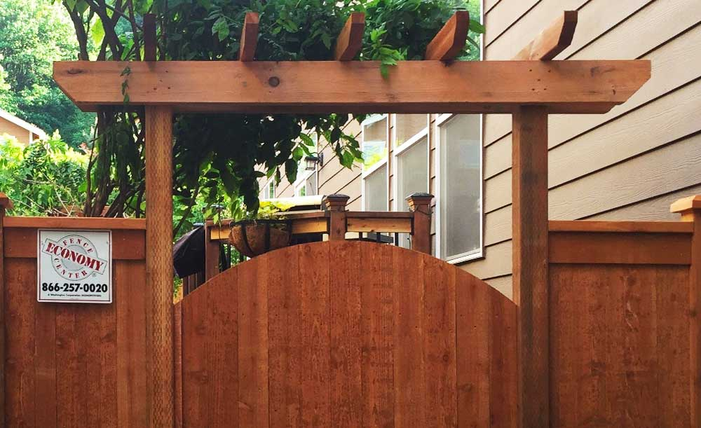 Modified Panel style pre-stained cedar fence and crown top gate with trellis