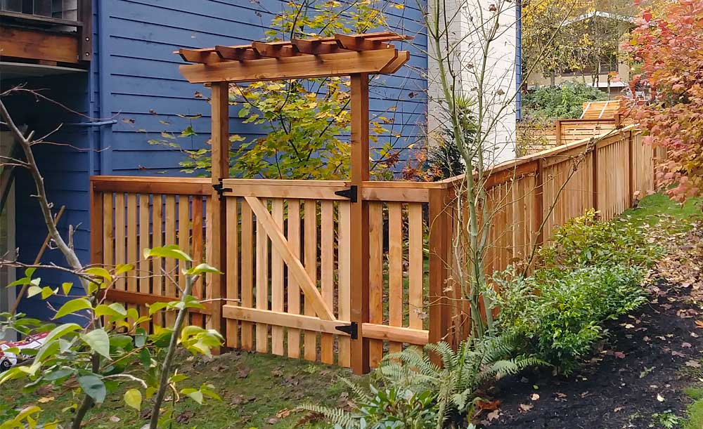 Modified Panel style cedar fence with space, gate and trellis