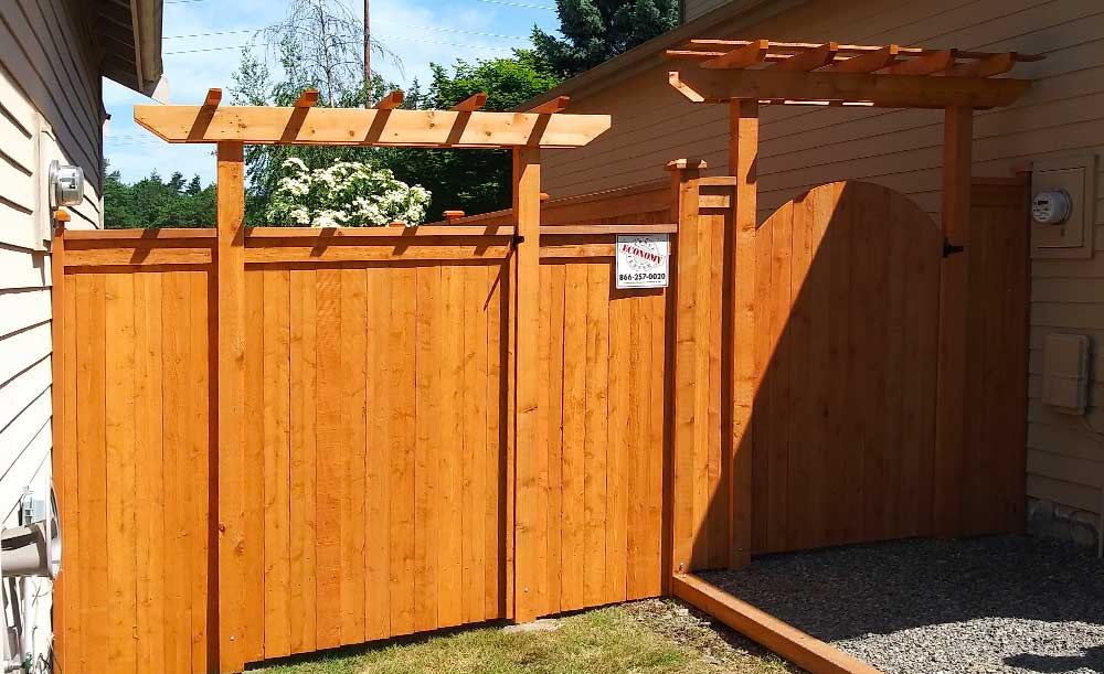Modified Panel style pre-stained cedar fence with cedar pipe-base posts, gates and trellis