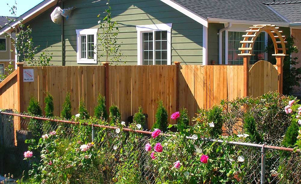 Estate style cedar fence with gateway arbor over gate