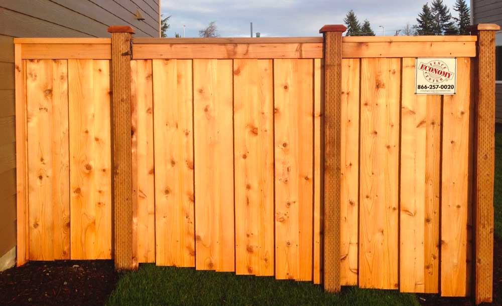 Board on board style cedar fence with single swing gate
