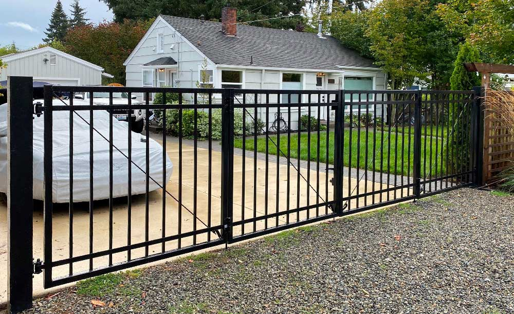 Custom iron bi-fold double swing gates