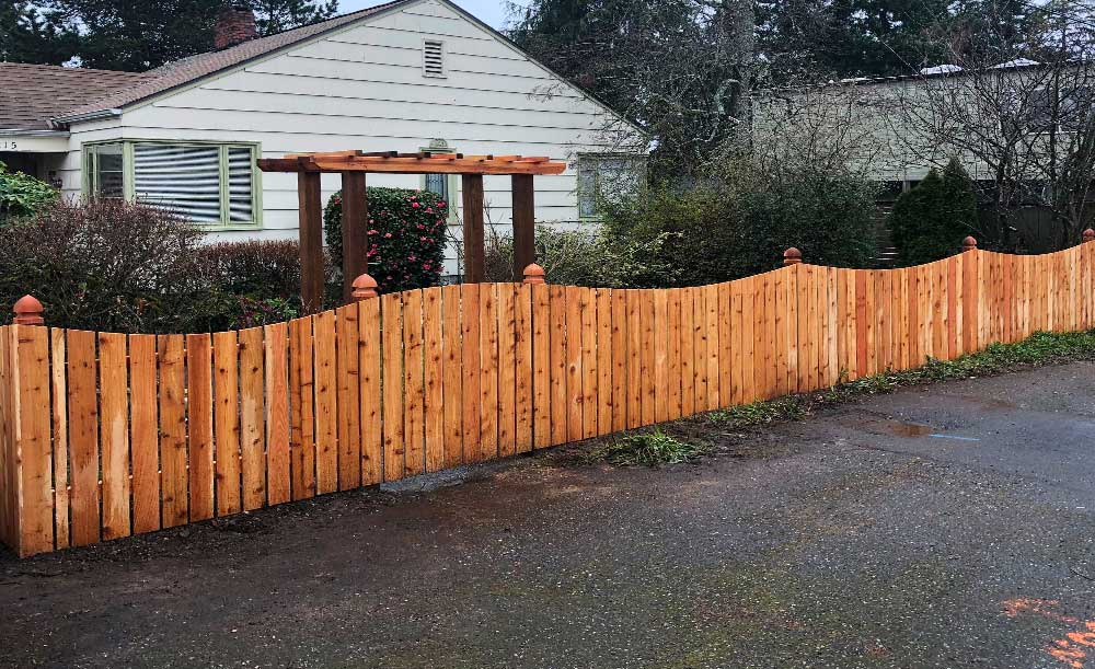 Crown Top style cedar fence with gothic post caps and 4-post trellis