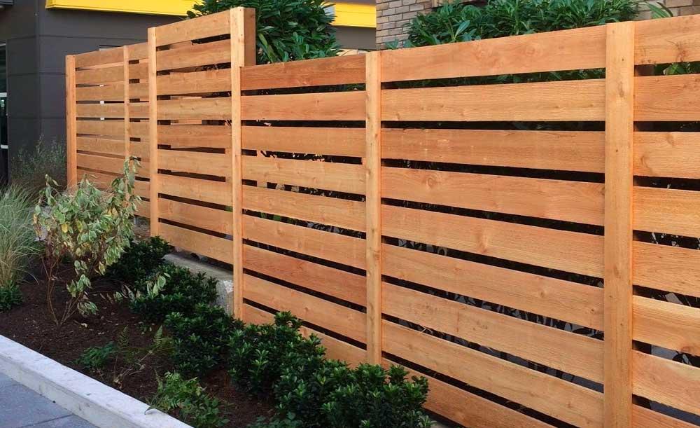 Horizonal style cedar fence with space