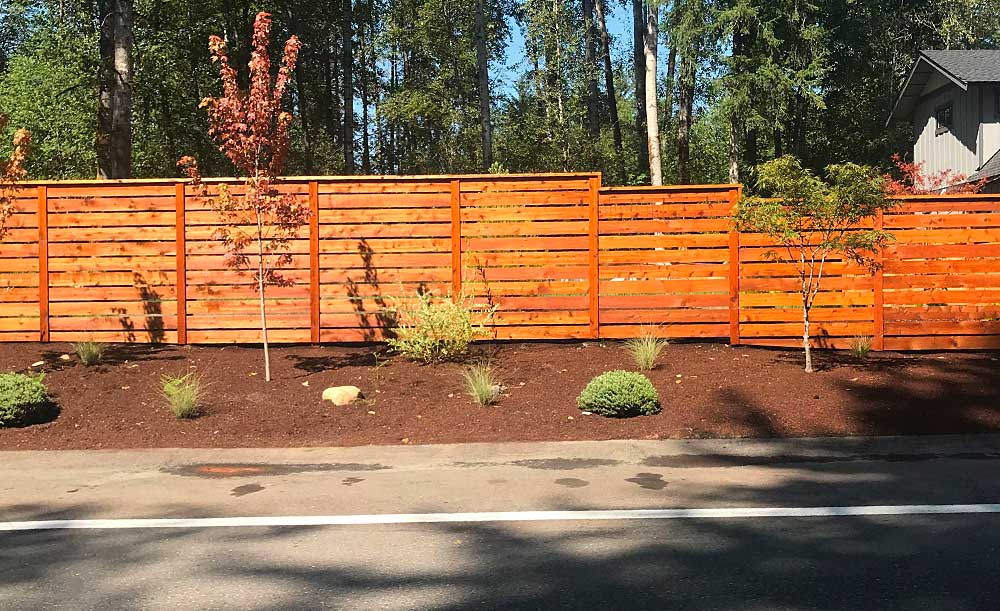 Horizontal style cedar fence with space