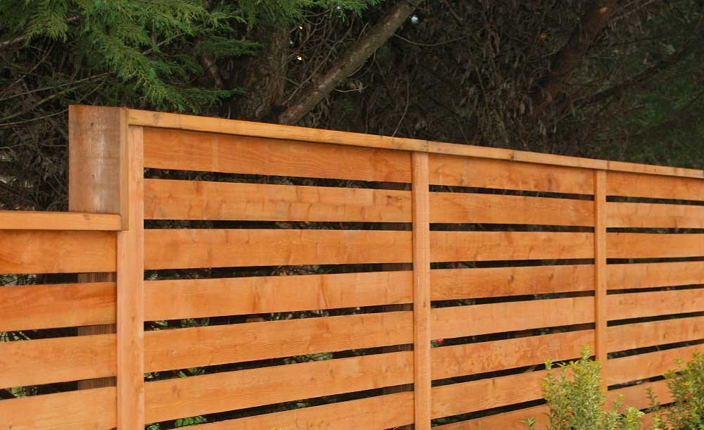 Horizontal style pre-stained cedar fence with space