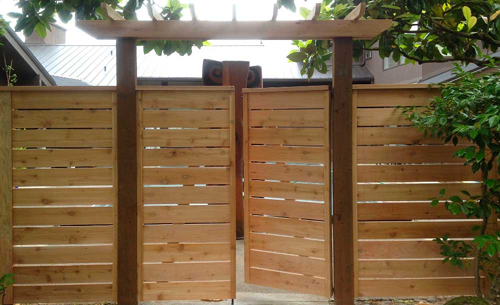 Horizontal style cedar fence with space, double swing gate and trellis
