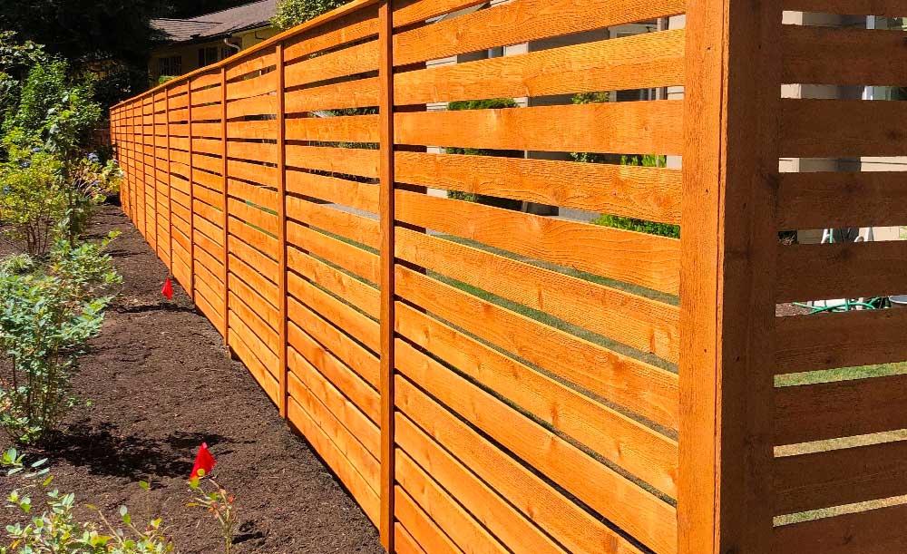 Horizontal style cedar fence with cedar pipe-base posts
