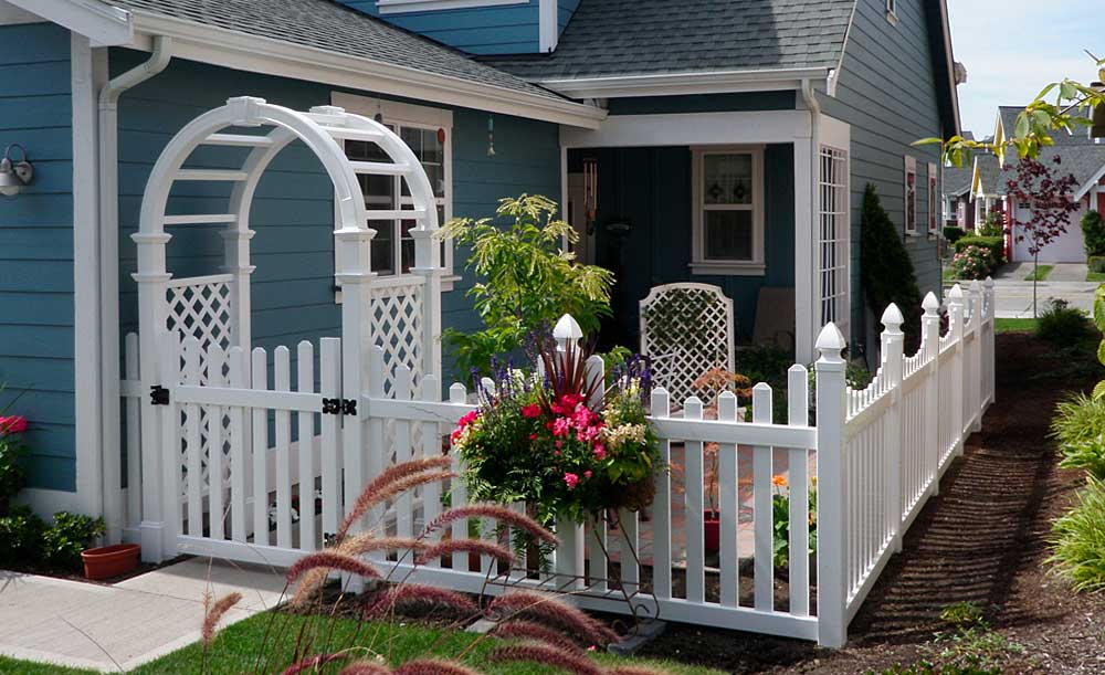 Scalloped picket fence with gate and arbor