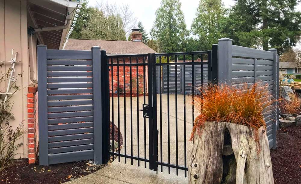 Weathered horizontal vinyl fence with gate