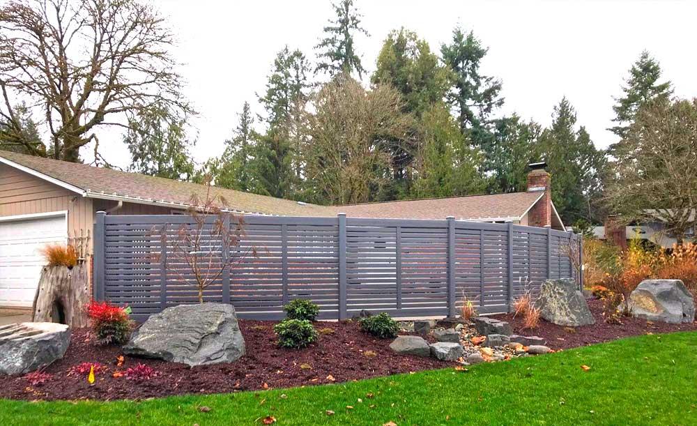 Weathered horizontal vinyl fence