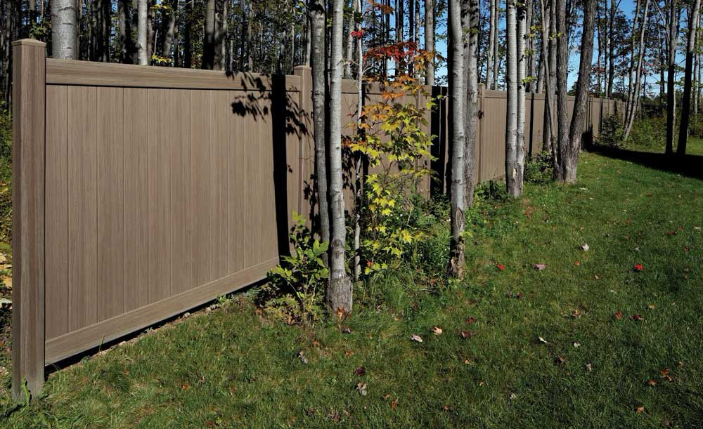 Weathered privacy vinyl fence